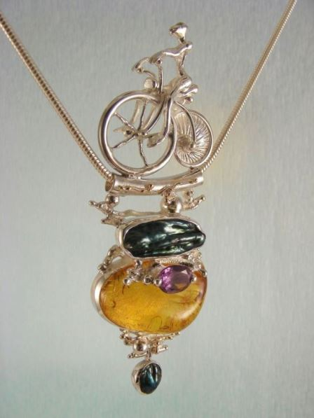 Gregory Pyra Piro One of a kind original handcrafted with superb detail craftsmanship and superb quality finish, only one available Bicycle Pendant 2533 in Sterling Silver and 14 Karat Gold with Amber, Amethyst, and pearls
