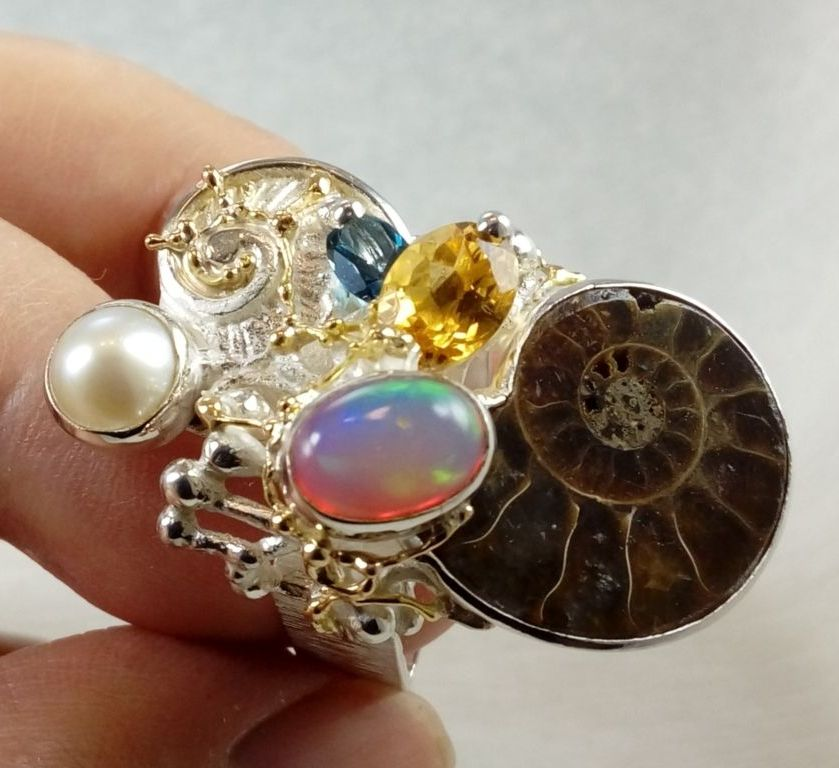 gregory pyra piro ring 374291, mixed metal jewellery made from gold and silver, auction style one of a kind jewellery made by jewellery maker, antique style handcrafted jewellery made by jewellery maker, unique design ring with ammonite and opal, unique design ring with citrine and blue topaz, unique design ring with ammonite and pearl, fine craft gallery jewellery for sale, art and craft gallery artisan handcrafted jewellery for sale, jewellery with ocean and seashell theme