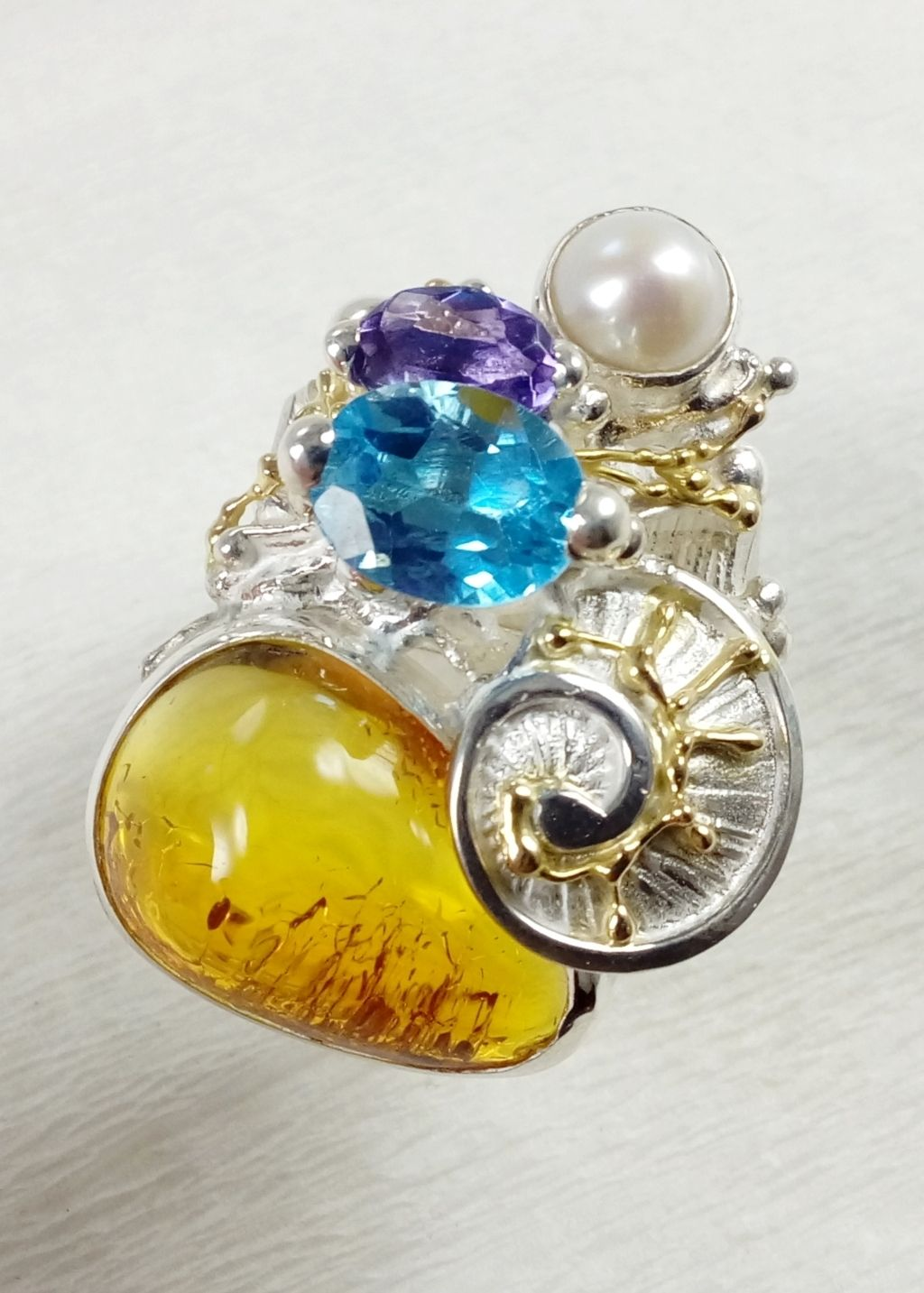 gregory pyra piro square ring 4822, craft gallery jewellery for sale, fine craft gallery handcrafted ring for sale, sterling silver and 14 karat gold ring, ring with amethyst and blue topaz, ring with blue topaz and amber, ring with amethyst and amber, one of a kind handcrafted ring, original handcrafted jewellery