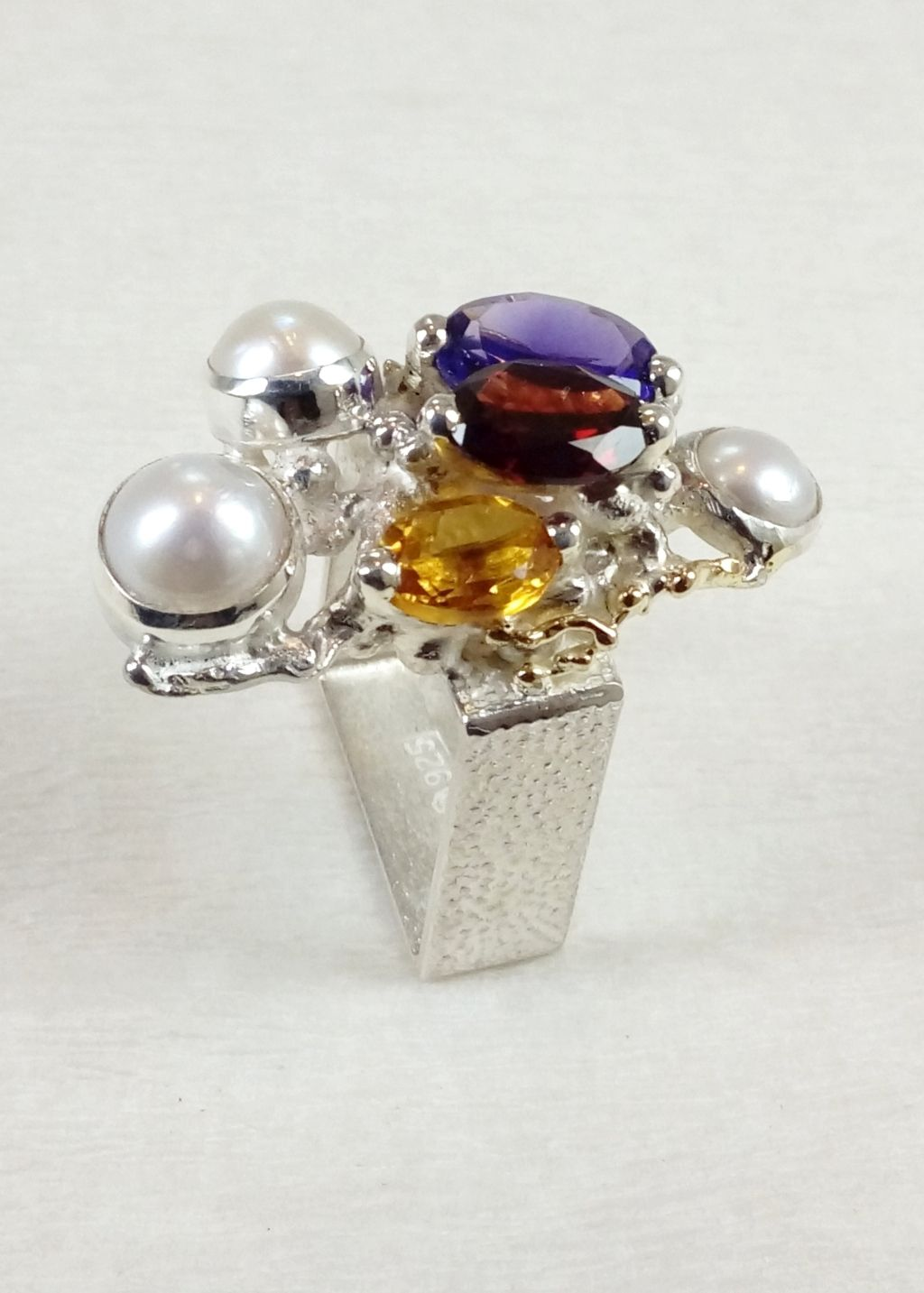 gregory pyra piro square ring 3250, fine craft gallery jewellery for sale, fine craft gallery ring for sale, artisan handcrafted rings for sale, craft gallery jewellery for sale, fine craft gallery handcrafted ring for sale, sterling silver and 14 karat gold rings, mixed metal jewellery, handcrafted ring with amethyst and garnet, handcrafted ring with citrine and garnet, handcrafted ring with amethyst and citrine