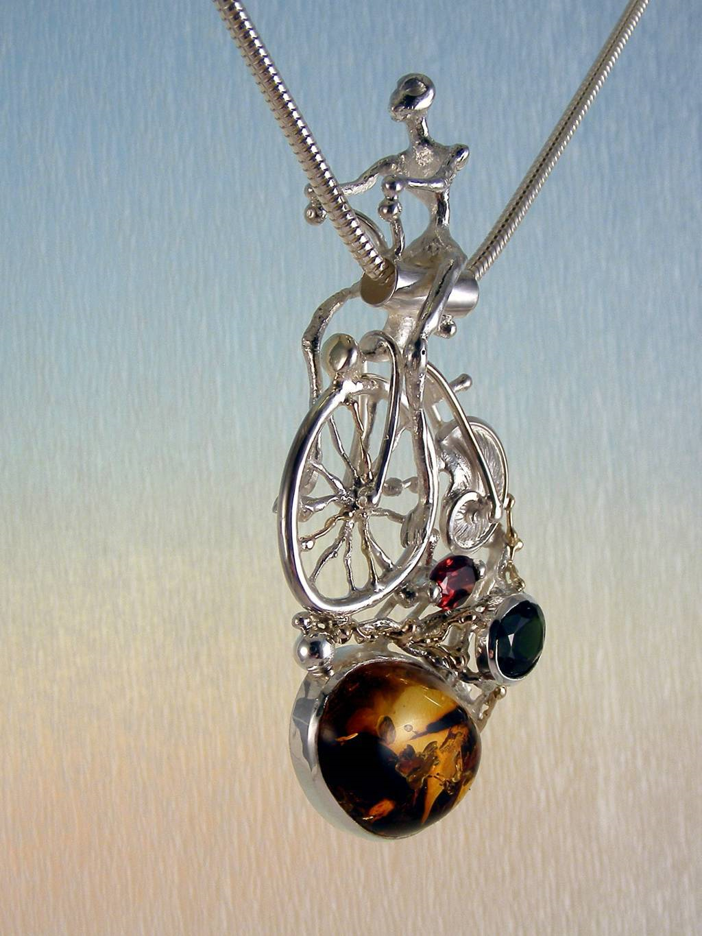gregory pyra piro sculptural pendant 4287, artists during lockdown making handcrafted jewellery, makers during lockdown who make handcrafted jewellery, galleries during lockdown with handcrafted jewellery, historical high wheel bicycle sculptural pendant, pendant with bicycle that has shell wheel, penedant with facted gemstones and amber, pendant with green tourmaline and garnet, jewellery sold in art galleries
